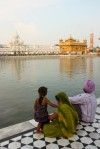 Sikh family overlooking Golden Temple